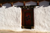 Bhutan - Paro: painted door with Taijitu, inside the Paro Dzong - photo by A.Ferrari