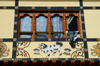 Bhutan - Paro: volcanoes - painting on the wall of a building - photo by A.Ferrari