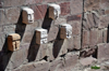 La Paz, Bolivia: carved stone heads of defeated enemies embedded in the wall - replica of the Tiahuanaco Templete Semisubter�neo - Tiwanaku Square - photo by M.Torres
