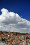 La Paz, Bolivia: south-western suburbs and El Alto - favelas, blue sky and white clouds - photo by M.Torres