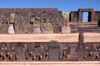 Tiwanaku / Tiahuanacu, Ingavi Province, La Paz Department, Bolivia: Semi-Underground Temple with carved enemy heads – Kalasasaya temple gate in the background - photo by C.Lovell
