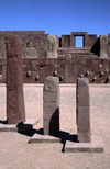 Tiwanaku / Tiahuanacu, Ingavi Province, La Paz Department, Bolivia: three steles in the Semi-Underground Temple – Kalasasaya gate in the background - Templete semisubterráneo - UNESCO world heritage site - photo by C.Lovell