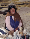 Tiwanaku / Tiahuanacu, Ingavi Province, La Paz Department, Bolivia: Aymara woman sells souvenirs in the nearby village of Tiwanaku - Bolivian Altiplano - photo by C.Lovell