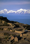 Isla del Sol, Lake Titicaca, Manco Kapac Province, La Paz Department, Bolivia: agricultural terraces - Nevado illampu (7010 m) is visible behind the village of Challapampa - photo by C.Lovell