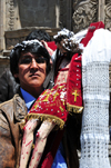 La Paz, Bolivia: man outside San Francisco church, holding with large crucifix, after thanking God for a granted request - Pace�o - photo by M.Torres