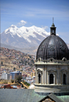La Paz, Bolivia: dome and drum lantern of the Metropolitan Cathedral against the Illimani mountain, the highest peak in the Cordillera Real, Andes - photo by M.Torres