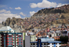 La Paz, Bolivia: eroded scarps and modest houses in the suburbs - photo by M.Torres