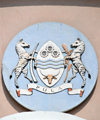 Gaborone, South-East District, Botswana: Coat of arms of Botswana - shiled with cog wheels, waves and bull's head - zebras holding elephant's tusks - 'Pula' means rain - National Assembly of Botswana - Government Enclave - photo by M.Torres