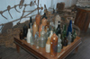 Brazil / Brasil - Porto Acre: memorial room - dug up bottles (photo by Marta Alves)