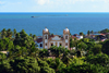 Olinda, Pernambuco, Brazil: Our Lady of Mount Carmel church seen from above, surrounded by vegetation with the Atlantic  ocean in the background - Historic Centre of the Town of Olinda, UNESCO World Heritage site - Igreja Santo Antônio do Carmo - photo by M.Torres