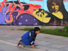 Bulgaria - Sofia: grafitti in Yuzhen Park - boy on a skate (photo by J.Kaman)