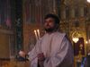 Bulgaria - Sofia: Inside Sveta Nedelya Cathedral - Bulgarian Orthodox priest with candles (photo by J.Kaman)