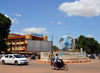 Ouagadougou, Burkina Faso: traffic on UN Roundabout / Rond-point des Nation Unies with is central globe and the post office building, Sonapost - Nelson Mandela Avenue - photo by M.Torres
