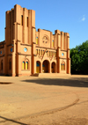 Ouagadougou, Burkina Faso: fa�ade of the Catholic Cathedral of the Immaculate Conception of Ouagadougou - built in mudbrick, with two steeples of different heights, neo romanesque style - built by Monseigneur Joanny Th�venoud of the White Fathers - photo by M.Torres