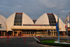 Bujumbura, Burundi: Bujumbura International Airport - BJM - landside - the building resembles a set of rugo traditional huts - photo by M.Torres