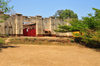 Gitega / Kitega, Burundi: old German fort - red gate and acacia - photo by M.Torres