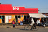 Bujumbura, Burundi: street scene - bicycle and shop sponsored by the mobile phone network Leo - photo by M.Torres