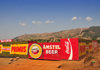 Rutana province, Burundi: Primus and Amstel beers sponsor a construction site wall, together with Coca-Cola - photo by M.Torres