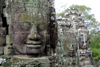 Angkor, Cambodia / Cambodge: Bayon - Giant sculpted faces of Jayavarman VII (Angkor Thom) - photo by R.Eime