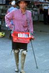 Cambodia: this man lost his legs in a landmine blast - amputee with prosthetic legs - prosthesis - photo by E.Petitalot