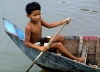Cambodia / Cambodge - Chong Khneas floating village: young boy paddles (photo by R.Eime)