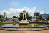 Cameroon, Douala: colonial heart of the city, the Government Square with a pond and the 1919 French monument honouring the death of World War I -  Place du Gouvernement, Le monument aux Morts - photo by M.Torres