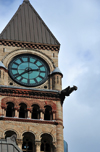 Toronto, Ontario, Canada: clock tower with gargoyle - Old City Hall - Romanesque Revival building designed by E.J. Lennox - Ontario Court of Justice - corner of Queen and Bay Streets - photo by M.Torres