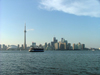 Toronto, Ontario, Canada / Kanada: skyline and Toronto Islands ferry in the Inner Harbour - day - photo by R.Grove