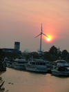 Toronto, Ontario, Canada / Kanada: the marina - sunset and wind turbine - wind generator - in the background Atlantis Pavilions and Liberty Grand hotel, ex-Ontario Government Building - photo by R.Grove
