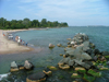 Toronto, Ontario, Canada / Kanada: beach and cairn - Centre Island - photo by R.Grove