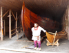 Canada / Kanada - Anse-aux-Meadows - Great Northern Peninsula, Newfoundland: a Viking and his ship - photo by B.Cloutier