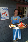 Canada 410 Waitress serving lobster at a restaurant in the fishing village of Halls Harbour, Nova Scotia, Canada. Model released. - photo by D.Smith