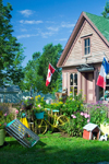 Canada 411 Scenic garden and antiques in front of store in Barton, Nova Scotia, Canada - photo by D.Smith