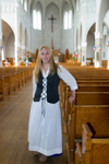 Canada 425 Young woman drssed in Acadian custume in a church in Metaghan, Acadian region of Nova Scotia, Canada - photo by D.Smith