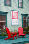 Canada 453 View of the front porch with red chairs of the historic Mahone Bay quilt shop in Mahone Bay, Nova Scotia, Canada - photo by D.Smith