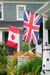Canada 455 Close-up view of a Canadian and British flag at a home in historic Mahone Bay, Nova Scotia, Canada - photo by D.Smith