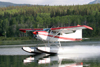 Skitine river, BC, Canada: seaplane - Cessna 185 Skywagon II, powered by a six cylinder 280 hp IO-550 engine from Teledyne Continental Motors - C-GORH - photo by R.Eime