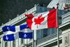 Montreal, Quebec, Canada: Canadian and Quebecer flags in front of the old Palace of Justice - Vieux palais de justice - Rue Notre Dame - Vieux-Montr�al - photo by M.Torres
