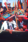 Vancouver, BC, Canada: Native North Amerian Indians wearing Indian art headgear in war canoes during canoe gathering at Capilano River, West Vancouver - photo by D.Smith