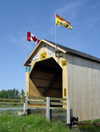Adair, Carleton County, New Brunswick, Canada: Adair Covered Bridge - Canada and NB flags - Howe Truss - photo by G.Frysinger