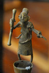Central African Republic figurine - woman with mortar and pestle, preparing cassava flour - photo by M.Torres