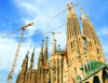 Barcelona, Catalonia: cranes and spires - Antoni Gaudí designed Temple Expiatori de la Sagrada Familia always under construction - photo by B.Henry