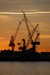 Barcelona, Catalonia: harbour cranes and red sky - photo by T.Marshall