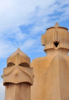 Barcelona, Catalonia: angry chimney and smiling access tower, roof of Casa Milà, La Pedrera, by Gaudi - UNESCO World Heritage Site - photo by M.Torres