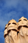 Barcelona, Catalonia: sky and chimneys of Casa Milà, La Pedrera, by Gaudi - UNESCO World Heritage Site - photo by M.Torres