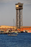 Barcelona, Catalonia: sailing by the Torre de Sant Sebastià (1931), Port Vell Aerial Tramway - architect Carles Buïgas - Barceloneta - photo by M.Torres