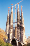 Catalonia - Barcelona: the Sacred Family Cathedral - always escorted by a crane / Sagrada Familia - Temple Expiatori de la Sagrada Fam�lia - the Passion fa�ade - photo by Miguel Torres