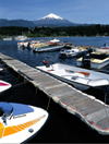 Araucanía Region, Chile - Pucón: Lake Villarica - boats in the marina and view of Villarica volcano - photo by Y.Baby