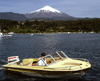 Araucanía Region, Chile - Pucón: Lake Villarica - small boat and view of Villarica volcano - photo by Y.Baby
