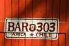 Chile - Arica: bar door painted as car license plate - puerta de un bar - photo by D.Smith